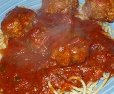 Penny s Spaghetti Sauce and Meatballs from Food.com:   								This is such a great meal to make in abundance. Serve it to a crowd AND freeze some for later. So many different uses, too. I sometimes make the sauce with the meat crumbled into it and use some of that sauce for lasagna and/or baked ziti. Hope you like it, too!