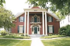 This is the Kappa house at the University of Kentucky.  My mom and her sisters were all active members of Kappa Kappa Gamma when they attended UK. Additionally, my mother is an accountant, and she did the books for the Kappa house for the first 10 or so years of my life.  This meant I spent I significant amount of time here when I was younger -- the girls babysat me, I knew all the Kappa cheers, etc.
