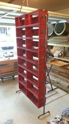 Dvd rack from pallets and plumbing pipe