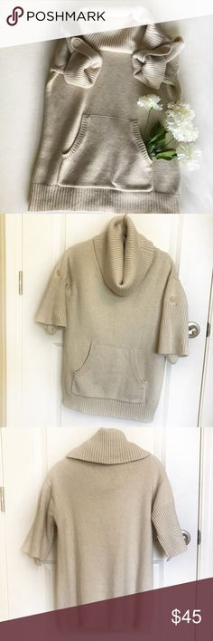BCBG Chunky Cowl Neck Sweater Off white. Gently used. Big and cozy. Adjustable roll up sleeves. Hello ❄️ Winter! 🌟FAST SHIPPER🌟❣️POSH AMBASSADOR❣️ Please comment with any questions. BCBGMaxAzria Sweaters Cowl & Turtlenecks
