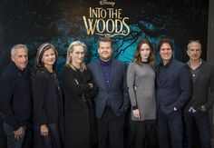"""The cast and crew of """"Into The Woods"""" pose for a promo still, 2015.  L to R: Co-producer Marc Platt, Tracey Ullman, Meryl Streep, James Corden, Emily Blunt, director Rob Marshall, co-producer John Deluca."""