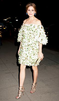 Olivia Palermo wears a floral off-the-shoulder Marchesa dress with strappy heels