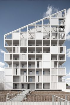 Housing in Nantes, France, by Antonini Darmon. Solid panels, perforated screens and recessed balconies create a patchwork of varying transparency for this mixed-use building.
