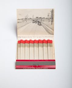 Krista Charles  |  Matchbook Views  |  For each match­book, I find where the loca­tion of the busi­ness would be in Google Maps and on the inside cover of the match­book I make a pen­cil sketch of what­ever is now shown at this loca­tion.