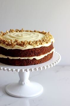 My all time favourite Carrot Cake recipe - loaded with grated carrot, crushed pineapple, crunchy walnuts and smothered in cream cheese frosting, this will become your favourite carrot cake recipe too! | thekiwicountrygirl.com