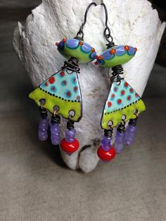 """""""Wild About Spring""""....with artisan enamels by Rhonda Harris, dangling lavender jade and lamp work by Anne Marie Sanders Ricketts and Lorna May Prime. You can find them here, https://www.facebook.com/Artisan-Jewelry-by-Cheryl-Zink-66…/ in my March album."""