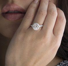 18 Karat Diamond Halo 8mm Round Forever Brilliant Charles and Colvard Moissanite Engagement Ring Solitaire Wedding. $2,650.00, via Etsy.