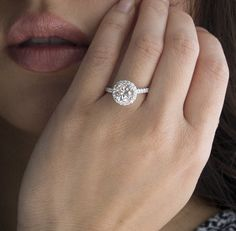 18 Karat Diamond Halo 8mm Round Forever Brilliant Charles and Colvard Moissanite Engagement Ring Solitaire Wedding. $2,650.00, via Etsy.