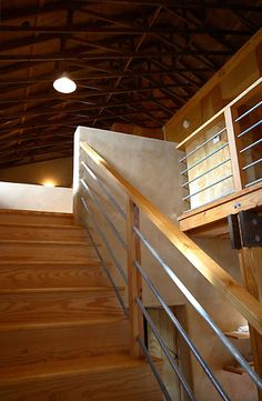 we are thinking of doing something similar for our ceiling. exposed beams and plywood... hmm