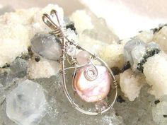 """ON SALE Small Pink Pearl Pendant, Pink Coin Pearl Pendant Solid Sterling Silver 935 Wire Wrapped in Argentium Anti Tarnish wire 18"""" by JewelrybyPatterson on Etsy"""