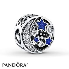 This ornamental charm from the PANDORA 2016 Winter Collection is inspired by the wonders of the night sky. A luminous moon and shimmering blue enamel stars reflect the wonders of a stellar sky on this majestic sterling silver button charm. Style # 791992CZ.