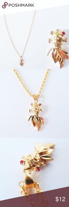 Yellow Goldfish Pendant Necklace Yellow Goldfish Necklace Gold Filled Chain and Pendant Goldfish has red stone eyes Total length: Pre-owned, like-new condition. Arrow Necklace, Gold Necklace, Pendant Necklace, Gold Filled Chain, Goldfish, Red Gold, Jewelry Necklaces, Women Jewelry, Pendants