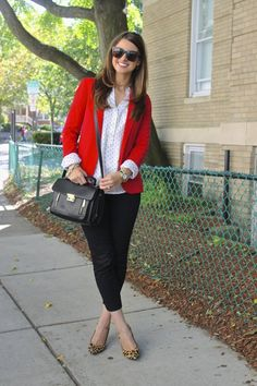 Red blazer with black & white. Love red, black and white together. Don't like the short pants though.