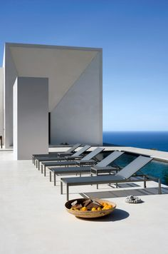 Lap pool and lounge chairs by Kettal _