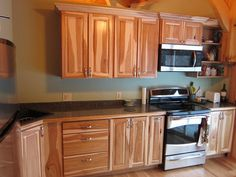 Here are stained hickory kitchen cabinets with a laminate countertop.