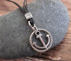 "Men's Necklace - Men's Anchor Necklace - Men's Silver Necklace - Mens Jewelry - Necklaces For Men - Jewelry For Men - Gift for Him  Looking for a gift for your man? You've found the perfect item for this!   The simple and beautiful necklace features 2 black wax wire chains with a silver plated anchor pendant.  Length: 21.5"" (55 cm). $25"