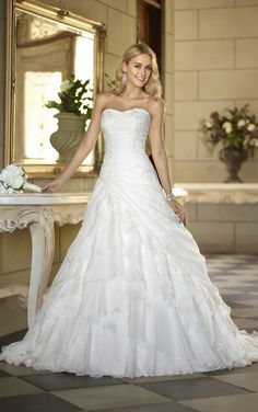 Strapless A-line wedding gown featuring a billowy Soft Organza tiered skirt from Stella York (Style 5795)