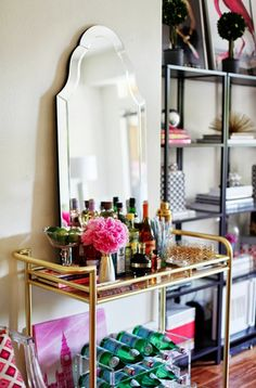 the mirror adds a vanity feel to this bar. So pretty! Style At Home: Devon Dyer Style At Home, Bar Cart Styling, Bar Cart Decor, Devon, Bar Deco, Decoration Inspiration, Decor Ideas, Interior Inspiration, Style Inspiration