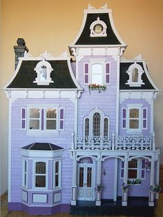 Is this gorgeous or what?  I would love to turn this Victorian into a purple, black and neon green Halloween decoration Haunted Mansion!!!!