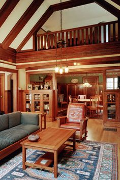 "The Gilliland House. A Gustav Stickley ""True"" Craftsman Style Home. Another view showing how the dining room is tucked cozily into the space under the balcony, providing a more intimate space for the ritual of the family repast."