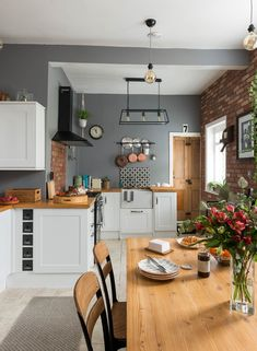 shaker style kitchen with grey walls, a wooden dining table, wooden worktops and. shaker style kitchen with grey walls, a wooden dining table, wooden worktops and industrial pendant lights ideas Grey Kitchen Walls, Kitchen Wall Colors, Home Decor Kitchen, Kitchen Interior, Kitchen Ideas, Kitchen Hacks, Diy Kitchen, Wooden Worktop Kitchen, Kitchen Feature Wall