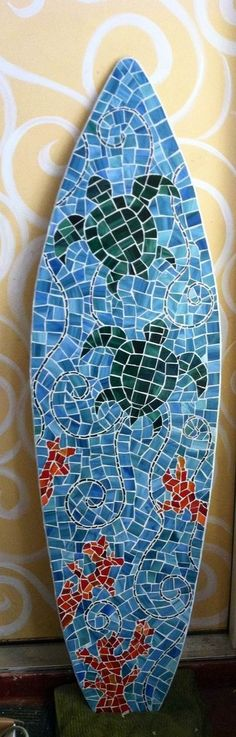 http://www.custommade.com/5ft-stained-glass-surfboard-mosaic-on-wood-wall-4/by/lucydesigns/
