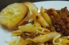 Italian Culinary Heritage: Penne Bolognese with Garlic Bread