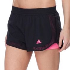 Adidas Climalite Double Layer Woven Shorts In excellent condition. Only worn a few times. Although they are different sizes I thought they fit similar and wore both. Will sell together or separate. Adidas Shorts