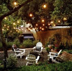 Backyard makeover | Flowers Point.          I like the lighting in the trees, would look nice on the balcony.