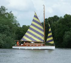 Sailing yacht on the Norfolk Broads: Great stripes