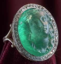 antique emerald cameo and diamond ring. Featuring an exquisitely carved emerald depicting a female face with flowing hair, framed by millegrain-set diamonds, mounted in platinum. Antique Engagement Rings, Antique Rings, Antique Jewelry, Vintage Jewelry, Ring Engagement, Cameo Jewelry, Jewelry Rings, Fine Jewelry, Jewelry Ideas