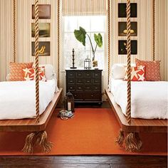 bedrooms - striped wallpaper roman shade black apothecary chest orange pillows accents orange rug guest room orange jute rug, twin hanging