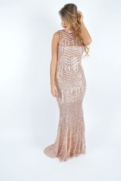 | Rose Gold Sequin Maxi | $84 | Foi Clothing | A long dress featuring symmetrical sequin pattern detailing all throughout | Mock neck with triple button closure | Sleeveless | Cutout & Low Back | Holiday Looks | Rose Gold Everything | Sequin Maxi Dress | NYE Sequin Outfit | New Year's Eve | Women's Fashion Sequin Maxi Dress | Christmas Dress | Stand out in this all sequin rose gold maxi |