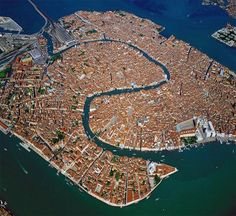 Venice, Italy. I never knew it was so big! When I was there on my honeymoon, at the age of 22, we arrived by train in the evening on a Sat nite. It was foggy, & sadly we didn't explore enough. Only saw the main canal & nearby areas.
