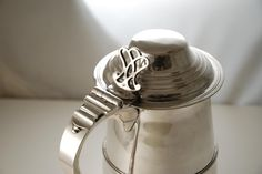 A silver tankard by Hester Bateman made in 1783. Female silversmiths were rare in Georgian England, and Hester Bateman is the most famous of them all.