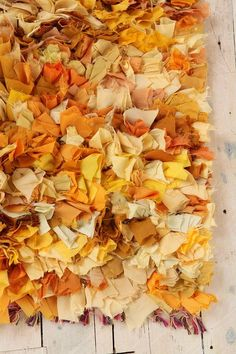 From Urban Outfitters. Learn how to make this type of rag rug at Craftaholics Anonymous..