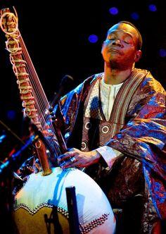 Toumani Diabaté, Malian, Musician. Excellent Kora (a kind of African harp) player.