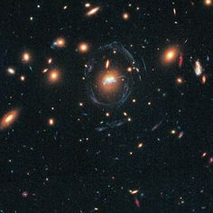 """This new Hubble Space Telescope image shows two galaxies from the cluster SDSS J1531+3414. The two galaxies have been found to be merging into one and a """"chain"""" of young stellar superclusters are seen winding around the galaxies' nuclei. - Image Credit: NASA, ESA/Hubble and Grant Tremblay (European Southern Observatory) - Image enhancement: Jean-Baptiste Faure"""