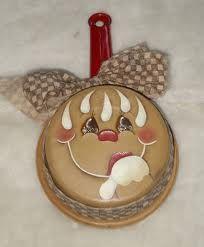 gingerbread face on old pot, diy