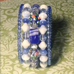 Blue jean wrap bracelet NWOT Blue jean wrap bracelet featuring lamp work and Czech glass. Sayre Jewelry Bracelets