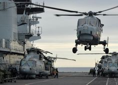 RN's new copter paid 1st visit to HMS Illustrious–dropping in on carrier during sub hunting ex off Cornwall.Wildcat,will replace Lynx on front line next year,touched down on Lusty during Ex Deep Blue.700W NAS,landed on veteran assault ship as it took part in biggest anti-sub ex RN run in decades,Deep Blue.9 Merlin Mk2s joined Lusty for 3week war game,which began off Lizard before moving out to Western Approaches.Merlins flying around clock as try to hunt Dutch diesel British nuclear boats.
