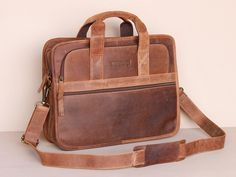 'The Scaramanga mens Citylander briefcase is tiptop in terms of craftsmanship, quality of leather and good strong stitching. The zips are also strong and Leather Work Bag, Leather Laptop Bag, Laptop Briefcase, Leather Briefcase, Laptop Bag For Women, College Bags, One Bag, Leather Accessories, Vintage Leather
