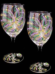 Mardi Gras Design Hand Painted Wine Glasses from www.wineablegifts.com