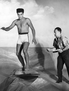 Elvis Presley learning how to pretend to surf on camera for PARADISE, HAWAIIAN STYLE (1966)