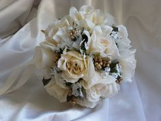 A personal favorite from my Etsy shop https://www.etsy.com/listing/217613682/ivory-rose-bouquet-with-tulle-and-gold