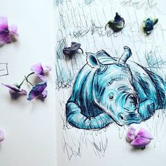 Rhino   #doodle #sketchbook #sketchoftheday #animal #flowers #blue #purple #art #illustration #arts_gate #looonalou #instaart #drawing #일러스트 #Nashorn #rhino #moleskine  #드로잉 #꽃