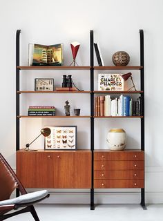 Convoy - this bookcase has lower storage space (to hide the mess), and open shelves for showcasing books & art. Attached directly to the wall with a great urban industrial feel