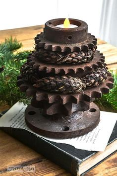 Rusty gear Christmas tree tea lights! Visit the post to visit all their 'different outfits!' :) via http://www.funkyjunkinteriors.net/ #12days72ideas