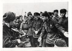 1943- Ukrainian captain sings a comic song to the accompaniment of a fiddle and a guitar as Red Army troops celebrate the receipt of luxuries like cigarettes, candy and magazines from their allies at the front.