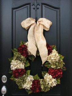 It doesn't matter which holiday is approaching. Thanksgiving, Christmas,  you name it.... as long as you have a black door, a wreath is going to look amazing. Guess I'll paint the front door black too!